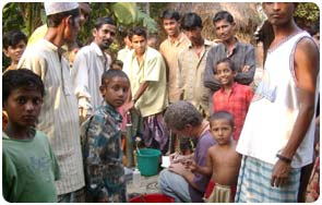 Dave Clark sampling a deep well in Bangladesh for arsenic and other chemical constituents